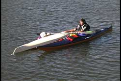 first paddler now begins to recover second paddler's kayak