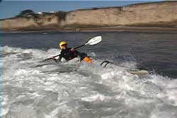 paddler getting back up in wave